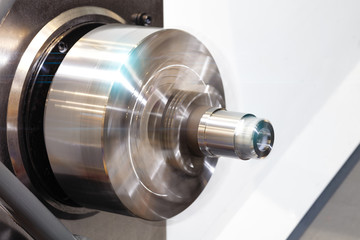 CNC lathe machine or Turning machine with rotating spindle with metal part