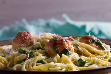 Spaghetti with spinach and chicken meatballs. Pasta with meatballs