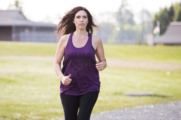 Healthy mature woman running outside