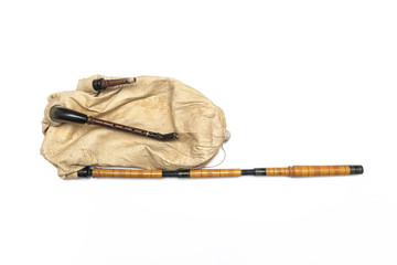 Traditional balkan bagpipe folk musical instrument. Isolated image on white background.