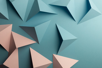 Close-up of pink and blue triangular shapes of paper, abstract background