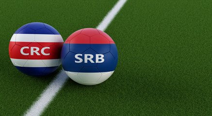 Costa Rica vs. Serbia Soccer Match - Soccer balls in Costa Ricas and Serbian national colors on a soccer field. Copy space on the right side - 3D Rendering