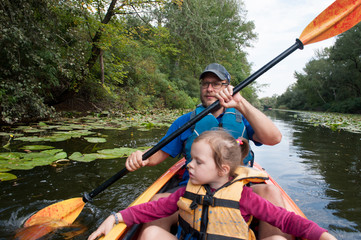 Father and daughter in a kayak on a water walk