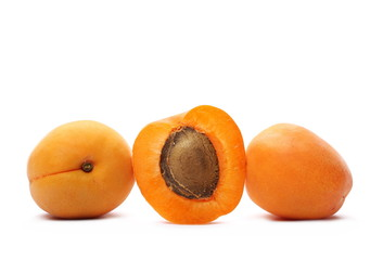 Cut fresh apricot fruits isolated on white background