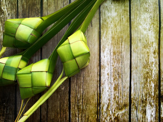 Ketupat (rice dumpling)  malay traditional food during eid mubarak on wooden background