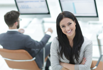 successful business woman on the background of a modern workplace