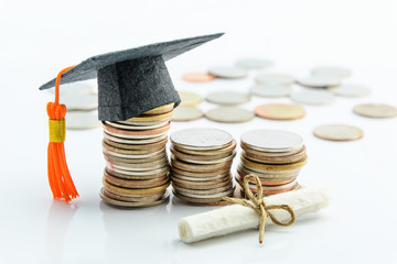 Money cost saving or money reserve for goal and success in school, higher level education concept : US dollar coins / cash, a black graduation cap or hat, a certificate / diploma on white background.