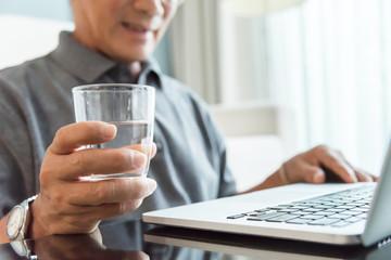 Senior man hand using laptop at his house.