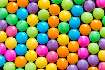 Pile of colorful sweet candy chocolates coated background. colourful collection