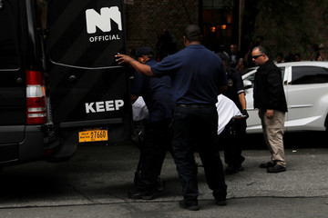 A gurney carrying the body of Kate Spade is taken from her apartment in Manhattan