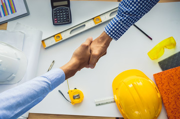 Architects who work with blueprints, inspecting workplace engineers for architectural planning, drafting construction projects