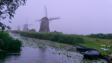 Dutch Windmill in dawn at the polder
