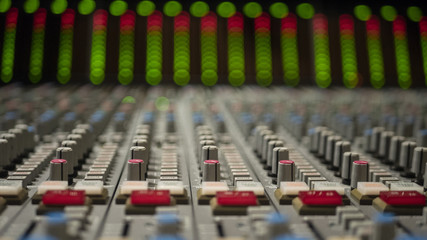 Mixing Board with blurry lights in the background