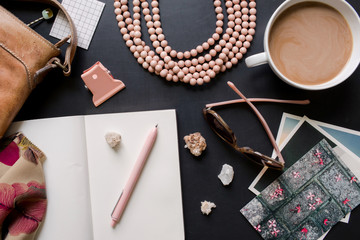 over a desk filled with things belonging to a woman