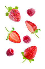 Fresh flying strawberries and raspberries isolated