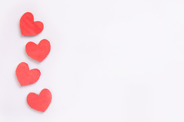 Red paper heart shape isolated on white with copy space