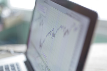 laptop with financial chart on the screen.close up