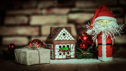 Christmas present on the background of a gingerbread house