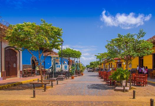 GRANADA, NICARAGUA - APRIL 28, 2016: View of market stalls at a colorful street in Granada, Nicaragua