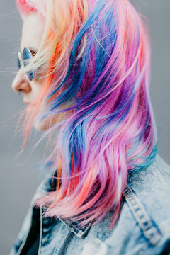 Woman with hair dyed in rainbow