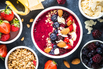 Smoothie bowl from fresh berries, nuts and granola.
