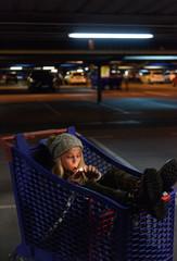 Woman smoking dope in shopping trolley