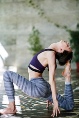 Woman practicing advanced yoga pose