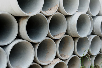 Close up concrete, cement pipes stacking,  pattern background. concrete pipes for irrigation