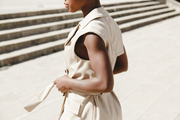 Black woman in camel clothes
