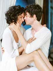 Tender couple in white embracing