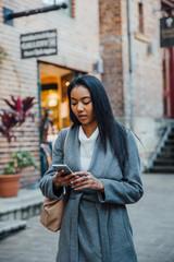 Young Woman Checks Phone