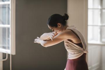 Ballerina Doing Exercise at Studio