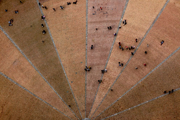 bird view view on a public place of a city in the tuscany
