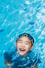 Happy Asian Kid in the Swimming Pool