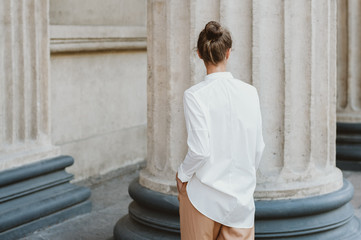 Back view of a woman wearing white shirt