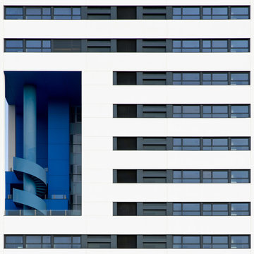 Modern office building with blue spiral stairs.