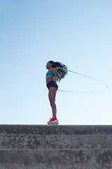 Young african athlete warming up with a jump rope