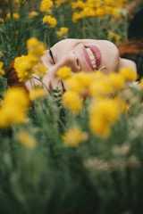 Red Haired Woman laying in flowers