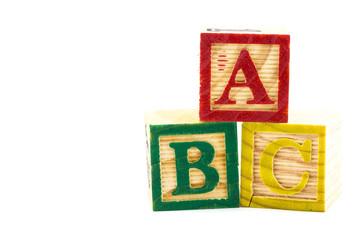 The wooden alphabet blocks on a white background