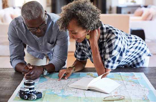 African American Senior Couple planning a trip in retirement