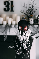 A  young boy dressed as an alien for a halloween party