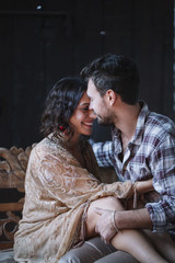 Young couple embracing and smiling