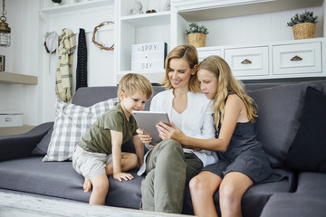 Woman using tablet with kids