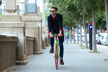Handsome man riding bike in the city.