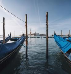 Gondolas at sunise in Venice lagoon, Italy
