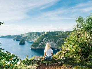 Girl enjoying view of ocean from cliff