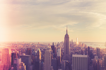 Wall Mural - Vintage style image of buildings across New York City at sunset with retro filter