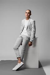 Man in grey suit - minimal fashion
