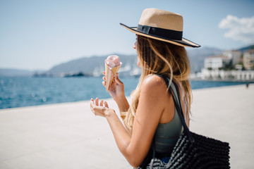 Woman holding a melting ice cream
