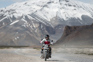 A Motorcycle Rider On A Mountain Road In Indian Himalayas